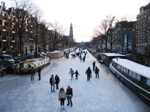 Skaters take to the ice on the frozen Prinsengracht canal in Amsterdam. Many of the city's canals also froze last year for the first time in more than a decade.