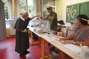 A nun votes in the second round of the French mayoral elections in Strasbourg, France