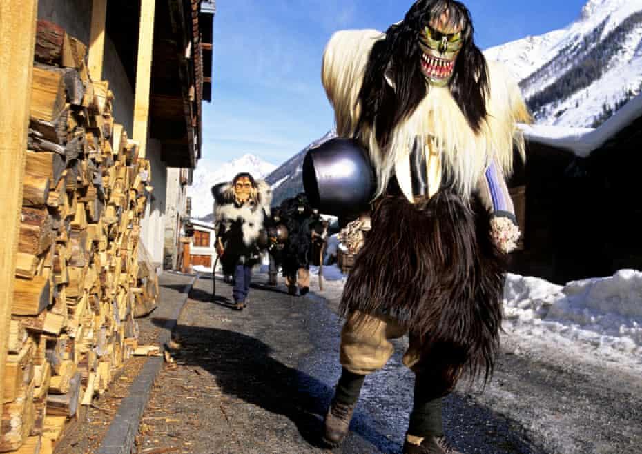 Super furry animals … Tschäggättä roaming Switzerland's Lötschental valley during the carnival.