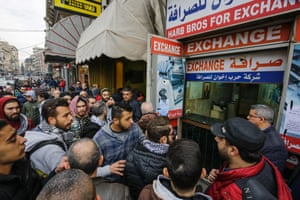Tripoli, Lebanon. Anti-government protesters gather at the entrance of an exchange office asking its owner to stop the exchange of US dollars