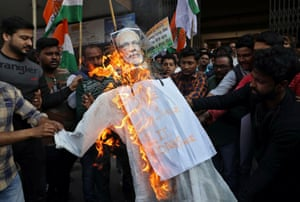 Kolkata, India: Demonstrators burn an effigy depicting India's prime minister, Narendra Modi, during a protest against the central government's plan to sell its stake in Life Insurance Corp (LIC)