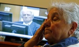 Smajlovic cries as she watches the Karadzik trial on TV