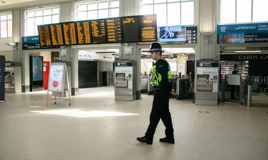 A British Transport Police officer at Wimbledon station in London on Monday as Britain slowly gets back to work.