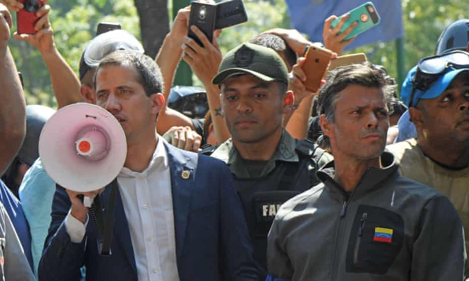 Leopoldo López (right) with Venezuelan opposition leader Juan Guaidó as he speaks to supporters last year.