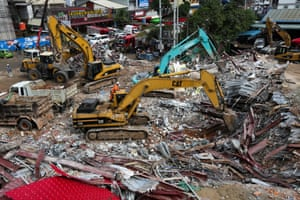 Earthmovers clear debris in Sihanoukville.
