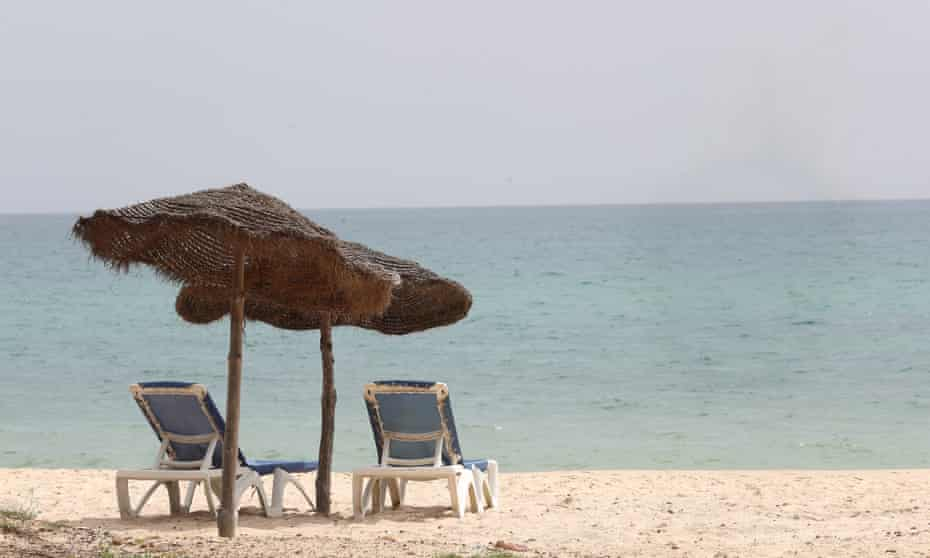 Empty sunbeds on a beach in Hammamet, Tunisia.