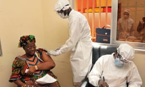 A woman receives an Ebola vaccine at a health centre in Conakry, Guinea, in March 2015.