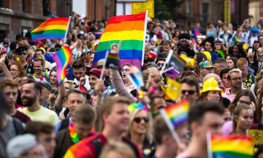 Crowds enjoying the Pride parade through Manchester city centre
