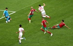 Sardar Azmoun's shot is saved by the feet of Muniz.