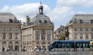 Bordeaux architecture with a tram in the foreground.