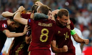 The Russian players celebrate that unlikely equaliser.