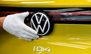 A technical employee cleans the paint in the final inspection at the production line for the electric Volkswagen model ID.4, in Zwickau, Germany,