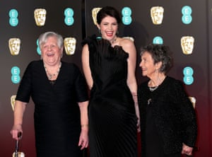 Gemma Arterton arrives on the red carpet with Eileen Pullen and Gwen Davis, two women who were part of the 1968 three-week walk out from Ford's Dagenham plant