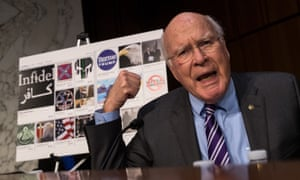 With examples of Russian-created Facebook pages behind him, Senator Patrick Leahy speaks on Capitol Hill.