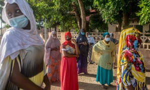 Voters queue at a primary school in Cotonou to cast their vote in Benin's local elections.