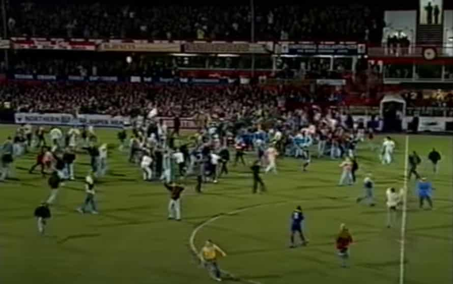 Joyous Sunderland fans flood on to the Roker Park pitch following their team's 2-1 win over Chelsea in their 1992 FA Cup quarter-final replay.