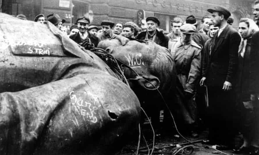 People gather around a fallen statue of Soviet leader Josef Stalin in Budapest, in 1956.