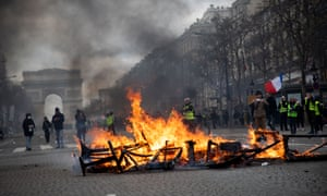 Rioters and protesters filled the Champs Élysées on Saturday