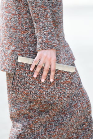 A tweed suit with matching clutch bag.