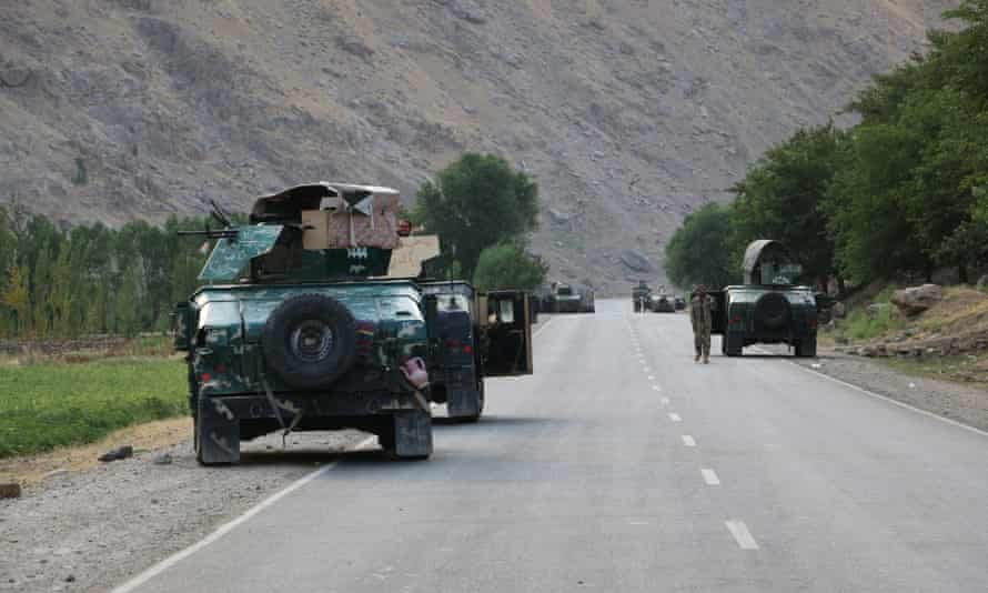 Afghan soldiers on a road at the frontline of fighting with the Taliban near the city of Badakhshan