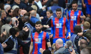 Crystal Palace's Mile Jedinak looks dejected after collecting his runners up medal.