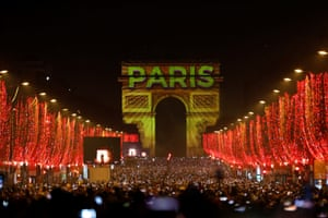 Thousands welcome the New Year in Paris.