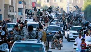 Using Islam 'to cover up their criminality' … Isis fighters parade through Raqqa.