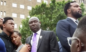 Benjamin Crump (in suit, left) and Lee Merritt (in suit, right) after the shooting of Botham Jean in his own apartment in Dallas by a police officer in 2018.