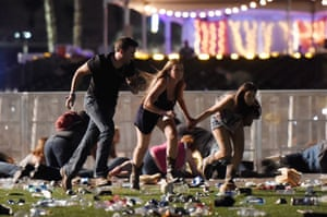 Las Vegas, US. People run from the Route 91 Harvest country music festival after a gun man opens fire