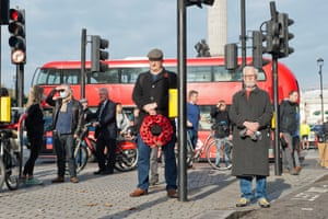 Callum Barnard, 27, lays a wreath on Remembrance Sunday for the first time despite lockdown restrictions in England. People had been asked to stay away from the cenotaph for the first time in history because of the continuing Covid-19 pandemic