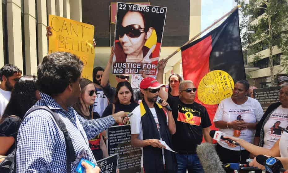 The family of Ms Dhu hold a rally with supporters outside a coronial inquest in Perth, Australia, on 2 December 2015, to call for justice for the 22-year-old Aboriginal woman who died in custody in 2014.
