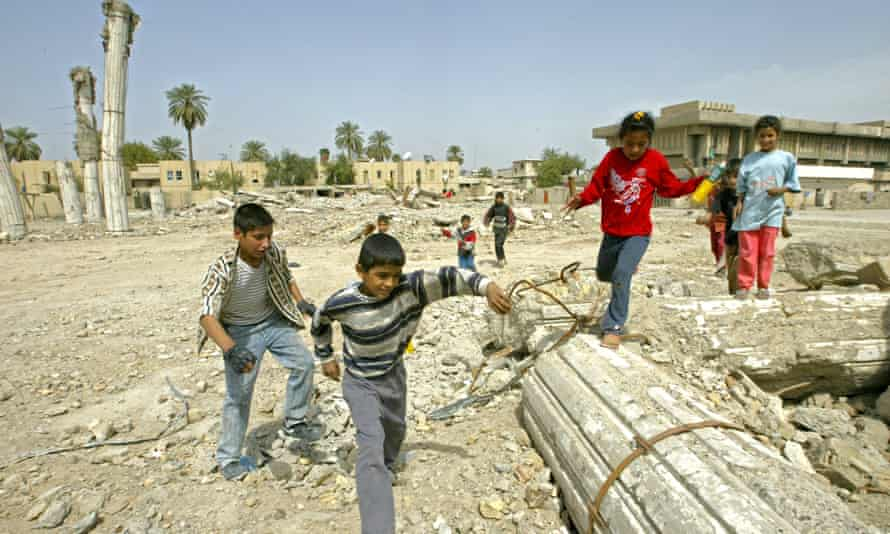 Children play in the ruins of the Iraqi Air Force Club, Baghdad, three years after the 2003 US-led invasion.