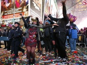 Revellers dance during celebrations in Times Square