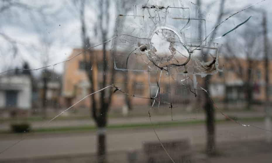 view of marinka seen through a window with a bullet hole in it