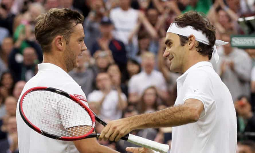 Marcus Willis (left) shakes hands with Roger Federer after their match on Centre Court.