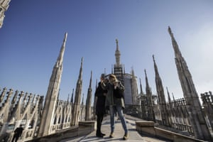 Milan, Italy. Visitors take selfies on the roof of the Duomo cathedral after it reopened following lockdown restrictions
