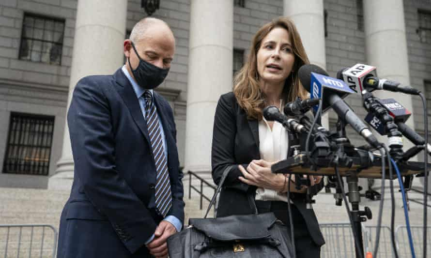 Michael Avenatti, left, stands with his lawyer Danya Perry during a news conference after he departs a sentencing hearing at Manhattan federal court on Thursday.