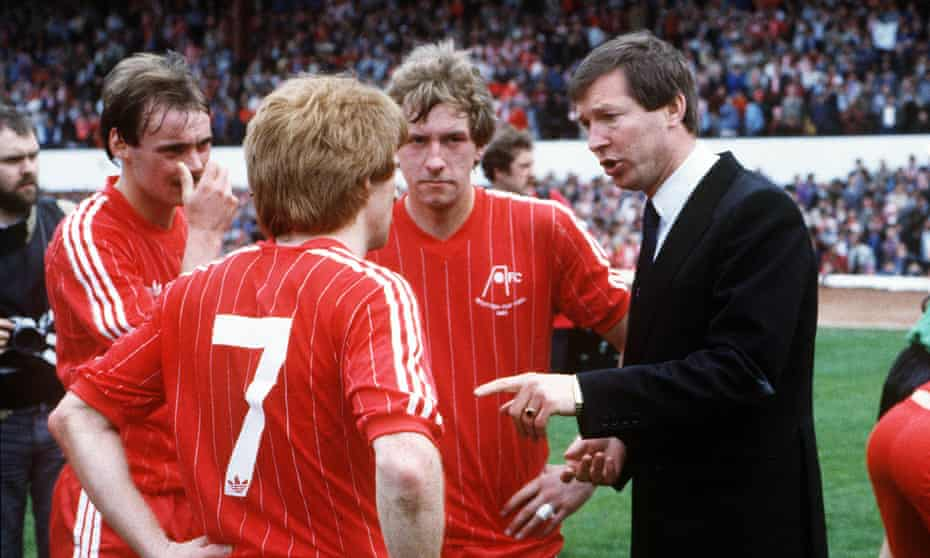 Aberdeen manager Alex Ferguson discusses team tactics before extra time at the 1983 Scottish Cup Final.