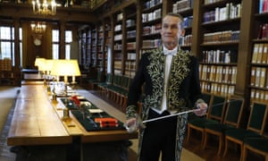 Russian author Andreï Makine poses at the library before his induction into the Académie Français in Paris.