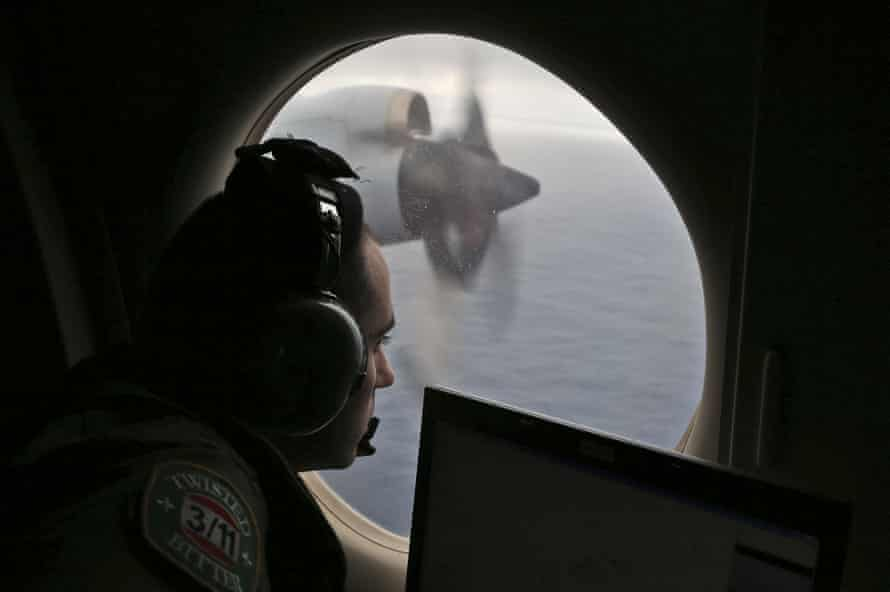 In this March 2014 photo, flight officer Rayan Gharazeddine on board a Royal Australian Air Force AP-3C Orion searches for the missing Malaysia Airlines Flight MH370 in southern Indian Ocean.