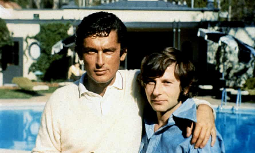 Evans, left, with director Roman Polanski in his book The Kid Stays in the Picture.