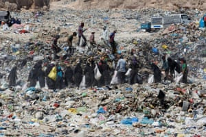 Najaf, Iraq. People collect recyclable litter at a dump