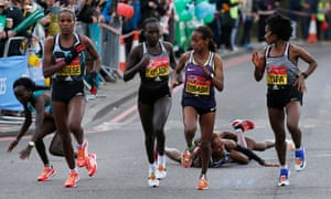 Ethiopia's Mare Dibaba, Tigist Tufa, Kenya's Florence Kiplagat and Ethiopia's Feyse Tadese in action as Kenya's Jemima Sumgong (hidden) falls during the women's race.