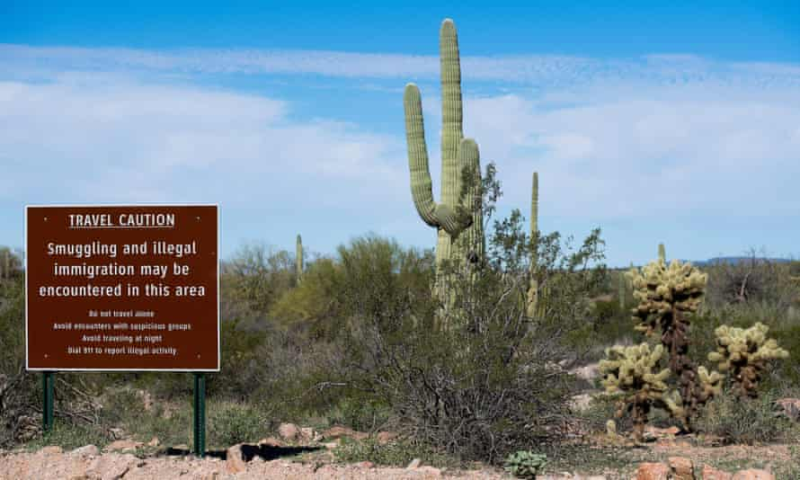 A sign warns against illegal smuggling and immigration near Lukeville, Arizona.