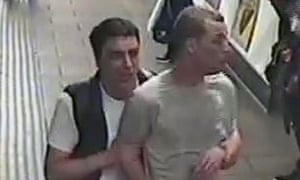 CCTV image of two men British Transport Police would like to speak to after gas was released on a London tube train.