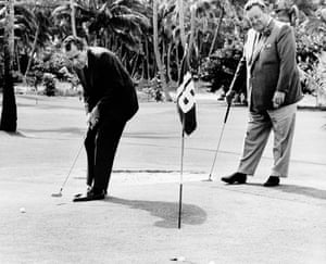 Richard Nixon sinks a putt with comedian Jackie Gleason in 1968.