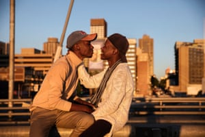Ofentse Sean Lewis (left) and his fiancé Sipho Lewis Maestro Azzuro (right) sitting on the Nelson Mandela bridge in Johannesburg
