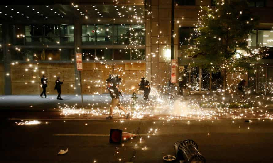 People run as police disperse protesters in Washington DC.