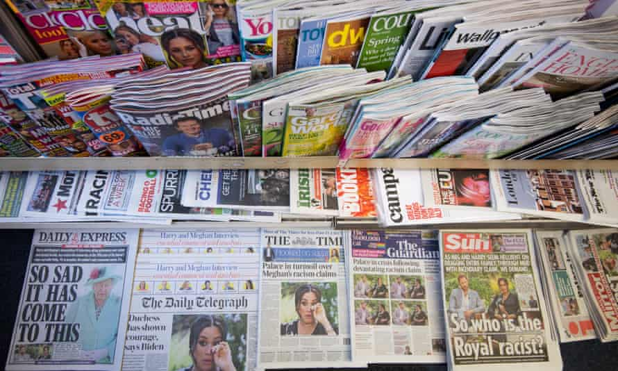 Newspapers on a news stand