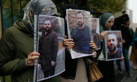 People hold portraits of Zelimkhan Khangoshvili in front of the German embassy in Tbilisi in September